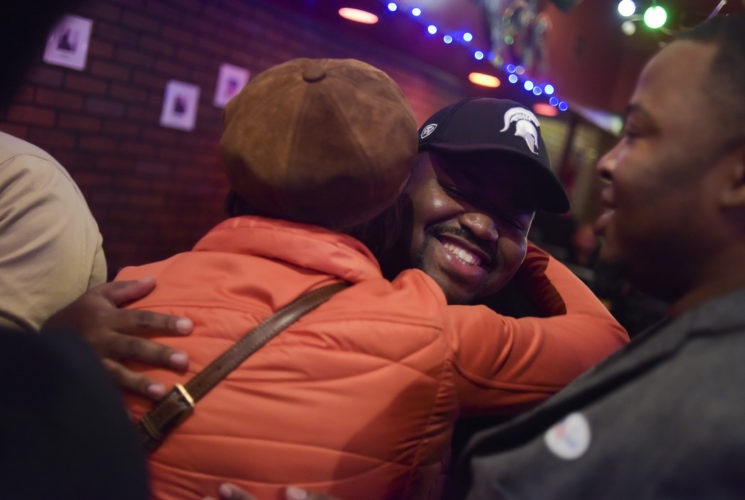 Mayor Karen Weaver, left, hugs Dondre Young at Raspberries Bar & Grill Tuesday, November 7, 2017 in downtown Flint. Incumbent Mayor Karen Weaver won the recall election with 54% of the vote. Mark Felix | Flint Beat