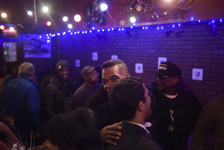 Flint City Council Member Eric Mays hugs a supporter at Raspberries Bar & Grill Tuesday, November 7, 2017 in downtown Flint. Incumbent Mayor Karen Weaver won the recall election with 54% of the vote. Mark Felix | Flint Beat