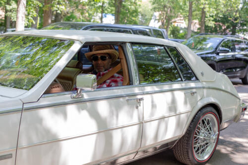 A Juneteenth participant poses in his classic car. (KT Kanazawich | Flint Beat)
